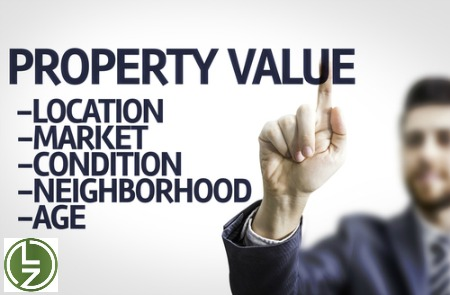 man-pointing-to-property-value